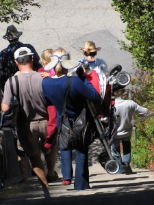 Large family with stroller walking down stairs from Depot Hill to Capitola Village