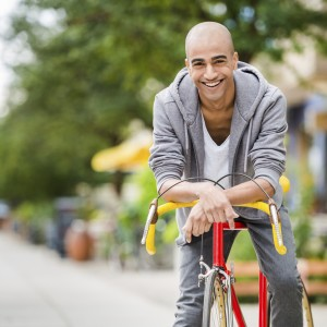 young man biking with smile